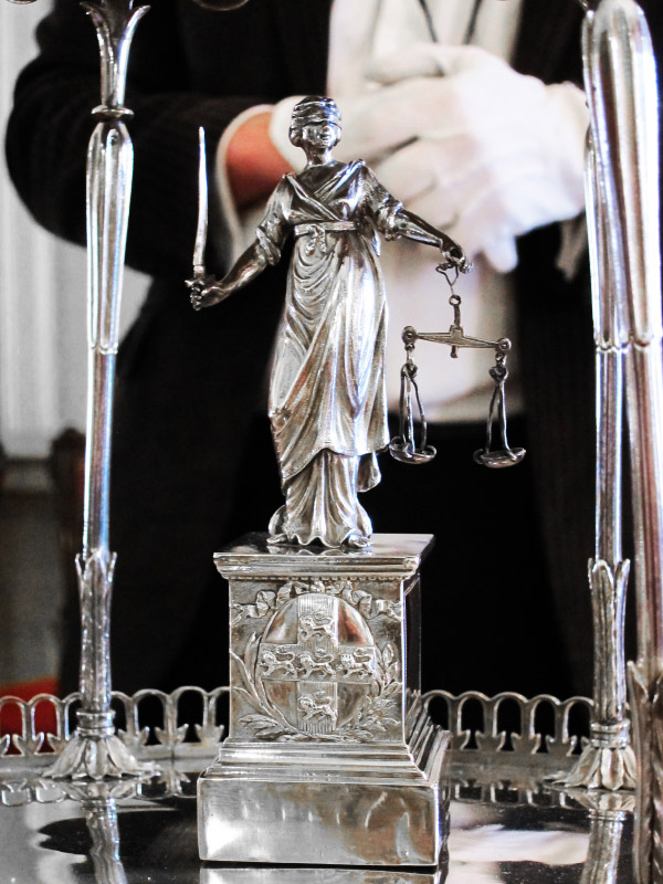 Lady Justice holds the Scales of Justice and the sword of Reason, balancing truth and justice on the stage of this silver tempietto, which features the coat of arms of the City of York. The elaborate piece is still used as a table decoration at Mansion House, home of the Lord Mayor of York.