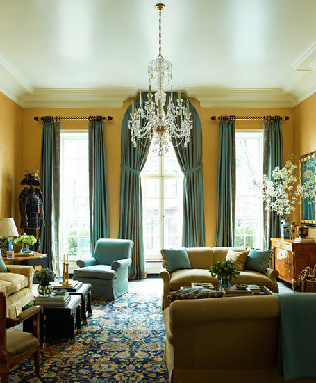 The living room of a town house on Manhattan's Upper East Side incorporates masculine and feminine motifs, plus Asian accents, all while concealing contemporary conveniences like a flat-screen TV.