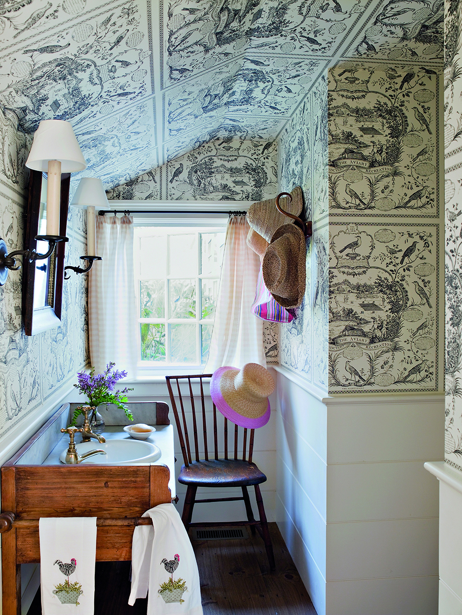 Scheerer used an American bird toile from Schumacher to help camouflage the odd angles of a pantry turned powder room in East Hampton, New York.