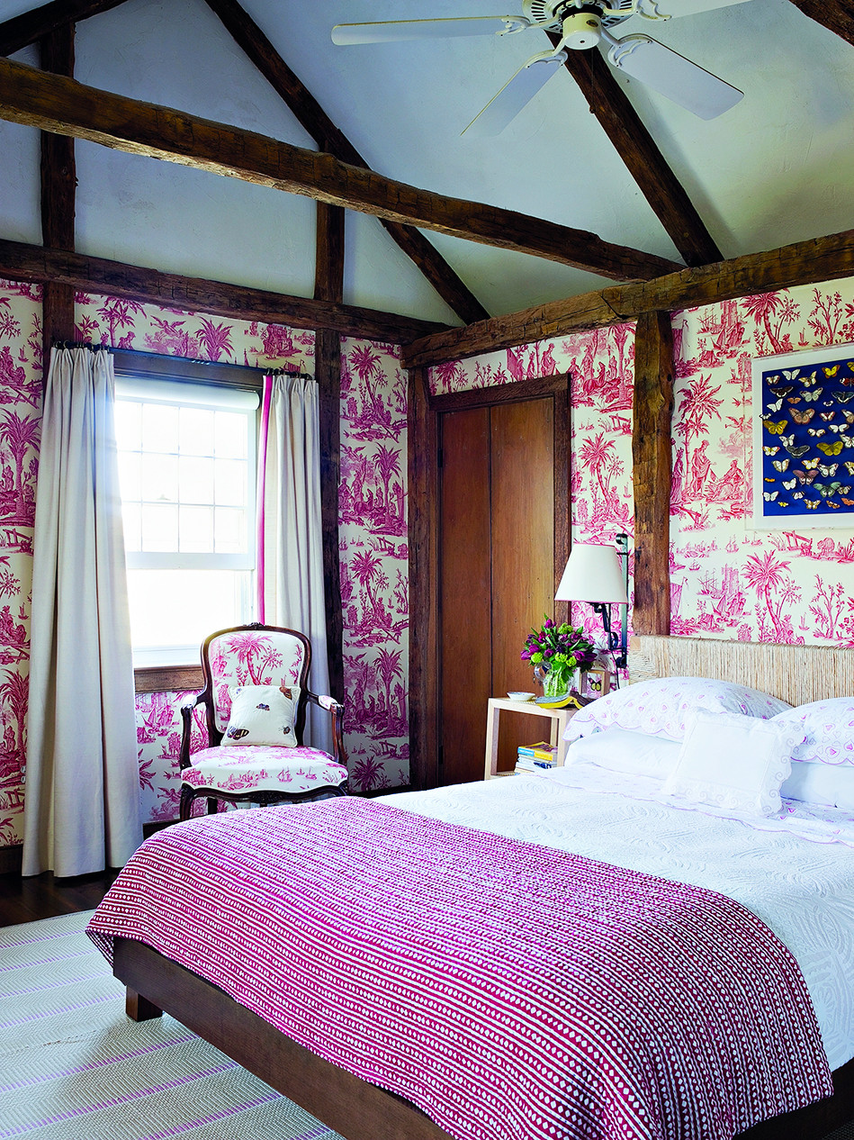 In an 18th-century farmhouse in East Hampton, New York, Scheerer created a bedroom at once modern and traditional, covering the walls and chair in Lafayette, a toile de Jouy from Quadrille Fabrics, and installing above the rope headboard a butterfly shadow box he made by hand.