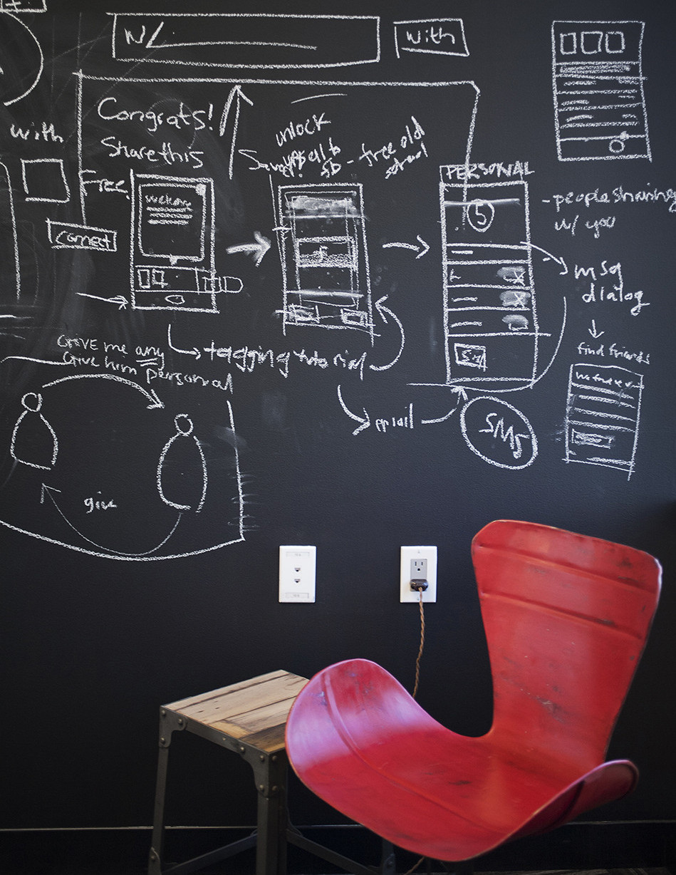 In a small phone room at the offices of Path, one of Geremia Design's earliest clients, a vintage chair keeps company with a chalkboard wall primed for note-taking. Photo by Keeney+Law Photography