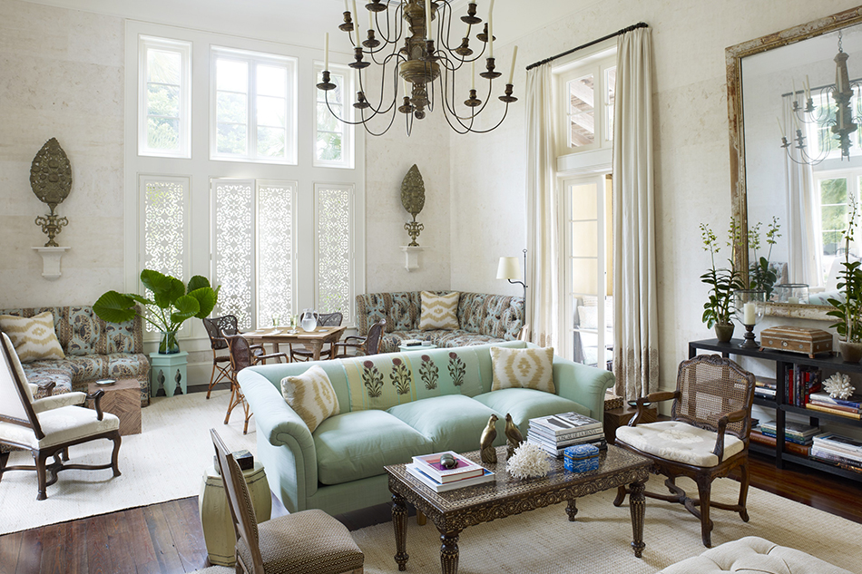 For a home in Hobe Sound, Florida, Scheerer drew inspiration from trips to Morocco, India, Cuba and Burma when creating this living room, where antiques, both French and exotic, mingle beneath 18-foot-high ceilings.