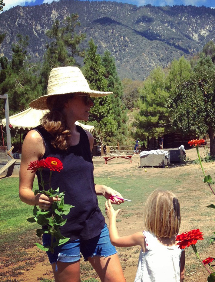 The designer has two young children of her own, including Honor, now five, seen here picking Gerber daisies with her mother at a California apple orchard. Photo by Chris Merrill