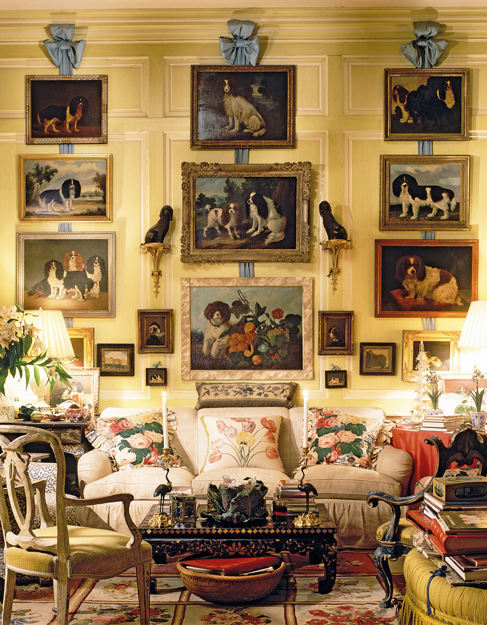"""Although he's never owned a dog of his own, Buatta has decorated his living room with portraits of pups, whom he calls his """"ancestors."""" Photo by Scott Frances"""
