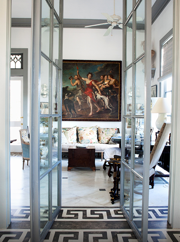 In the Peacock House, a pair of French doors that Gatewood found at the Pier Antiques Show, in New York, open to a living room dominated by a painting of Diana, goddess of the hunt.