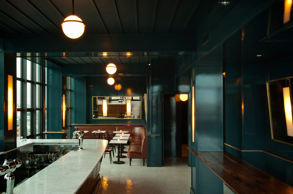 The green-blue-gray undertones of the glossy color Workstead chose for the Wyeth's Ides bar subtly shift with the natural light that pours through the rooftop space's wall of windows.