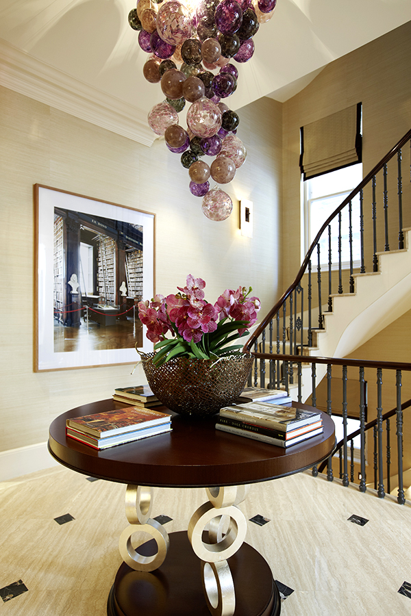 British decorator Joanna Wood (previous page) wears many hats: running an eponymous shop on London's Pimlico Road; designing fabrics, wallpapers, furniture and lighting through a trio of beloved product lines; and creating modern-classic interiors around the world - like this entryway in a townhouse in London's Kensington district. All photos courtesy of Joanna Wood