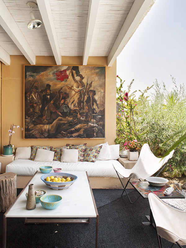 A contemporary take by the painter Arnaud on a classic Eugene Delacroix painting of the French Revolution hangs in the indoor-outdoor living room of a house in the Spanish town of Almería.