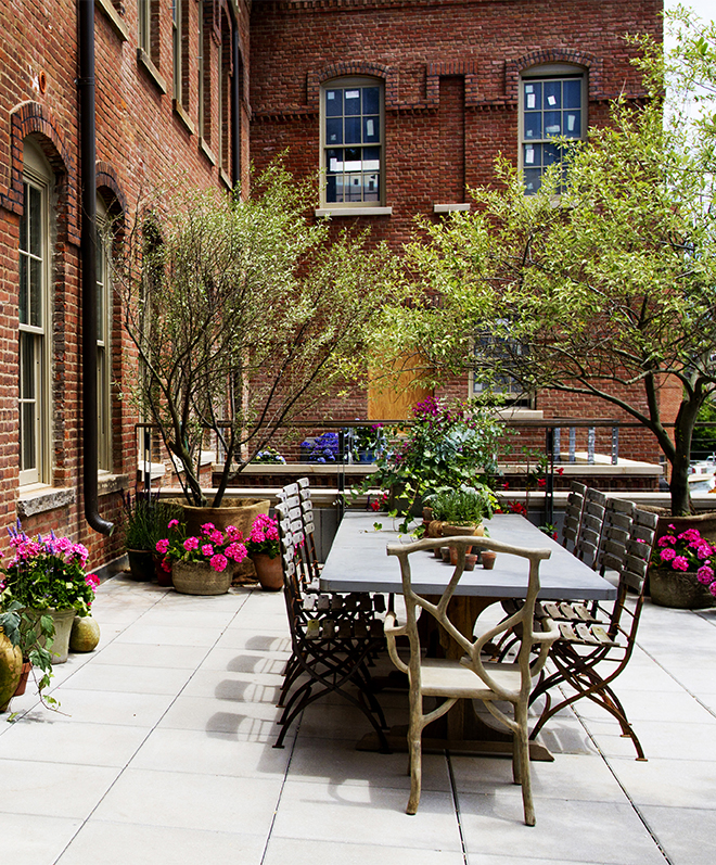 Milly de Cabrol and Ani Antreasyan transformed a terrace into a sweet-smelling escape using a pair of lime trees, a variety of plantings and furniture from Mecox Gardens. Photo by Rikki Snyder