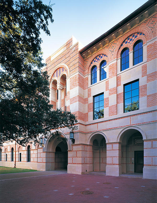 The facade of the new Humanities Building at Rice University (2000) expands upon the Byzantine-Romanesque architecture of the century-old surrounding buildings. Photo by Wade Zimmerman