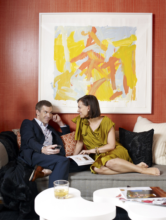 Carrier and Miller in their T&CITAL Showhouse, beneath an abstract painting by one of their favorite artists, Leah Durner. Photo by Francesco Lagnese