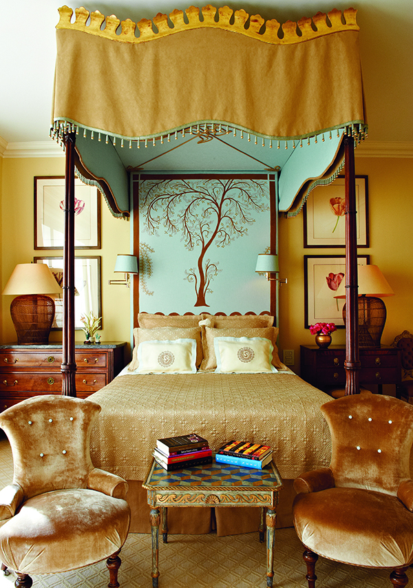 Stokes's bed was inspired by one she saw at Mallett Antiques in London. The bedside lamps are made from Indonesian fish traps with paper drum shapes, as opposed to pleated silk, for a more casual look.