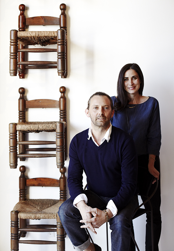 Nickey and Kehoe pose beside wood-and-rush fireplace stools, which are available on their 1stdibs storefront. Photo by Giovanni Jance