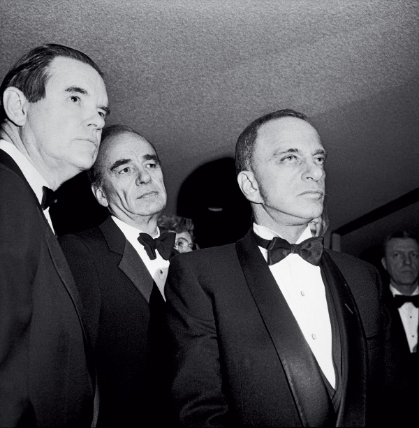 From left: Tom Bolan, Rupert Murdoch and Roy Cohn at a party during Ronald Reagan's inauguration, Washington, D.C. (January 21, 1985)