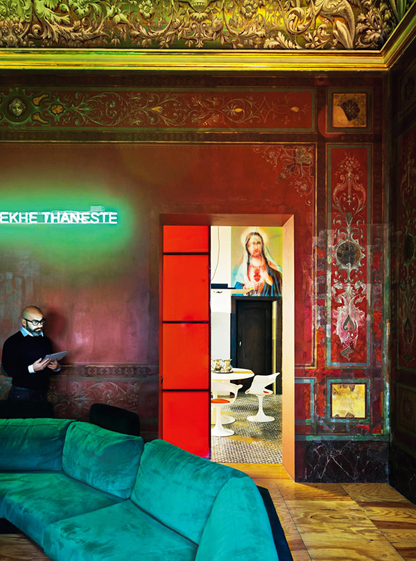"""The inclusion in AD of the Naples """"Red Salon"""" of architect Antonio G. Martiniello (pictured) — where a maxi-divan and contemporary neon artwork contrast with the palatial frescoed ceiling — demonstrates Kalt's affinity for the quirky. © Jérôme Galland"""
