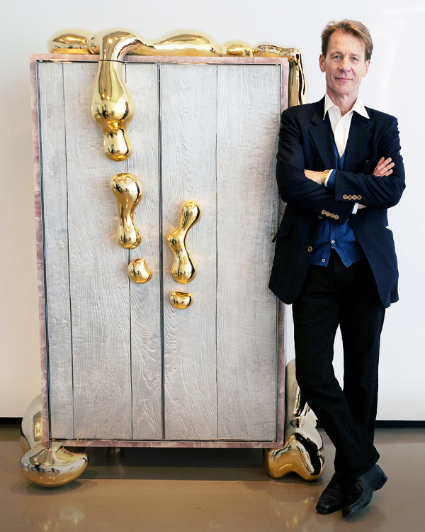 Bonetti stands next to one of his boldest new creations: the Liquid Gold cabinet, 2012, made of cast aluminum that looks like wood grain, with translucent pink rock crystal borders and gold-plated bronze decorations. Photo by Billy Farrell, BFAnyc.com.