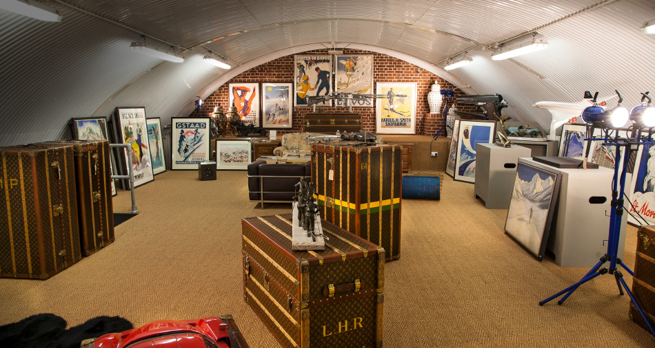 For the globe-trotting customer: original Art Deco winter sports posters hang alongside vintage Louis Vuitton trunks.