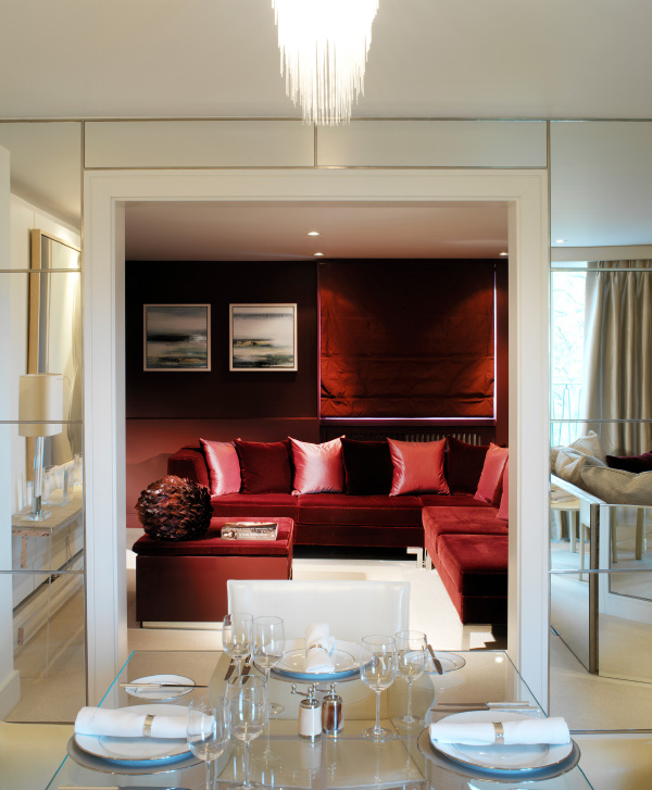 Fox Linton installed a deep-red sofa of her own design in an apartment in London's Belgravia.