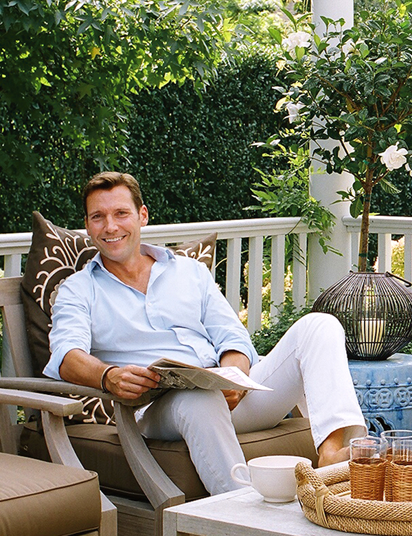 Timothy Whealon relaxes on the comfortably furnished deck of his Southampton home