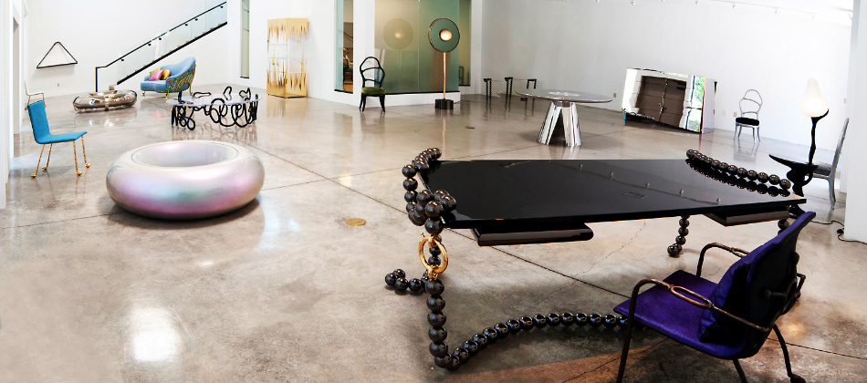 A 2011 exhibition at Michael S. Smith's LA gallery, Duke & Duke, featured, among other objects, Bonetti's Tokyo coffee table and Broken Pearl Necklace desk, both in foreground.
