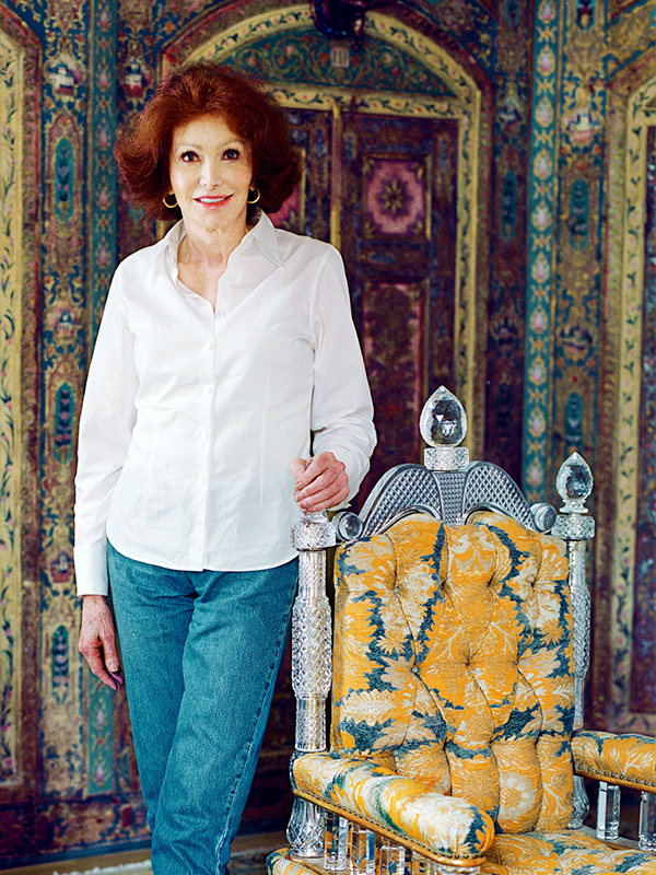 Ann Getty in her work clothes at her San Francisco home. 18th-century Syro-Turkish, hand painted, gilded and semi-precious stone-ornamented panelled guest bedroom. Cut glass-crystal throne chair (circa 1894, Birmingham, England) from F & C Osler. Photo exclusive by Lisa Romerein. Top: In the romantic dining room of the Trainas' house, the folding dining chairs are from the Ann Getty House Collection. Custom-colored and printed velvet on the banquettes is by Venice-based Sabina Fay Braxton. The peacocks, from Deyrolle, were a gift from Danielle Steel.