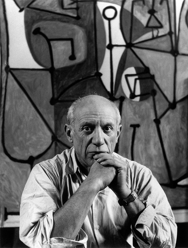Picasso in his Paris studio on the rue des Grands-Augustins in front of The Kitchen, 1948. Photo by Herbert List/Magnum Photos