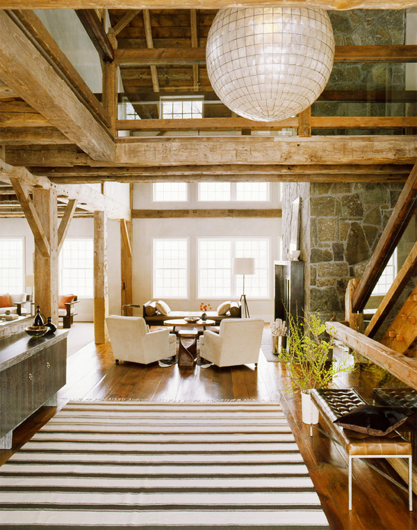 A Washington, Connecticut, residence, with a large capiz shell chandelier above the entryway and beautiful exposed wood beams, hints at interior designer S. Russell Groves's nature-inspired aesthetic. Photo by Eric Piasecki. Preceding page: photo courtesy of SRG.