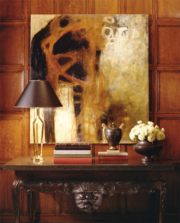 A view of a Kips Bay bedroom. The brass lamp, designed by Smyth, sits on an 18th-century Irish console from Kentshire. The oil painting is by Melinda Stickney-Gibson.