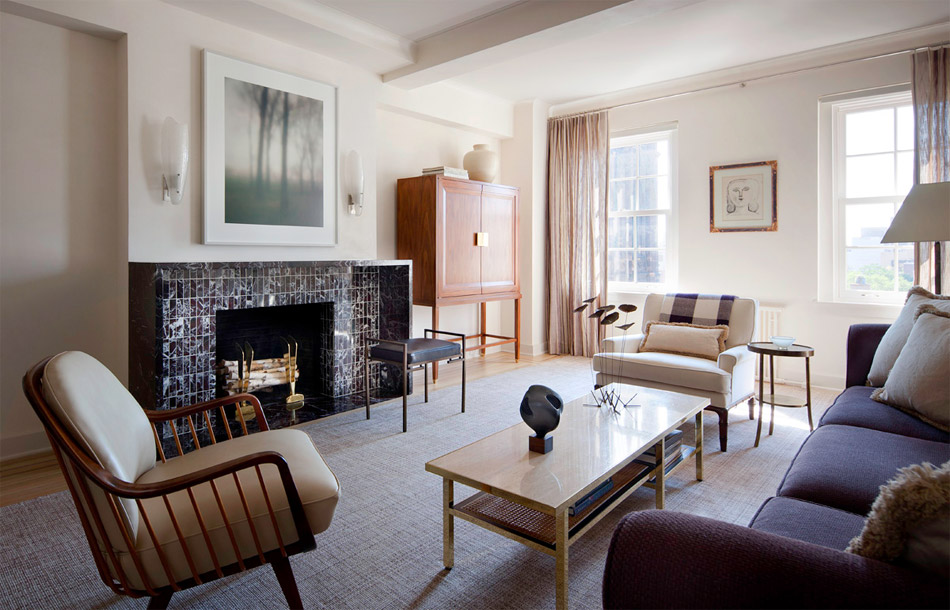 In New York, a lower Fifth Avenue apartment features a 1930s-inspired fireplace flanked by a custom-made television cabinet.