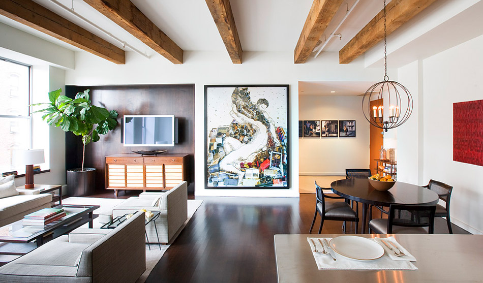 "The living room of a loft in Chelsea exemplifies Henderson's penchant for harmoniously balancing ""what's happening decoratively and architecturally."" The photograph is by Vik Muniz."