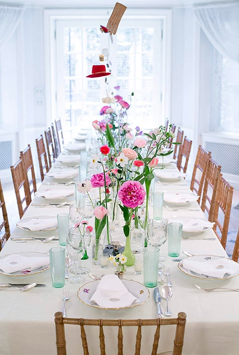 dining table with floral centerpiece