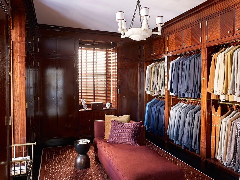A walk-in closet by David Kleinberg Design Associates