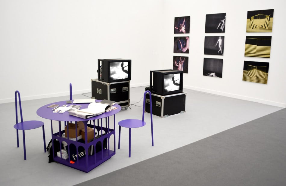 A purple table-and-chair set by Harry Nuriev makes an eye-popping combination with black-and-white works by Hans Breder in the Ethan Cohen Gallery booth at Frieze New York, 2018
