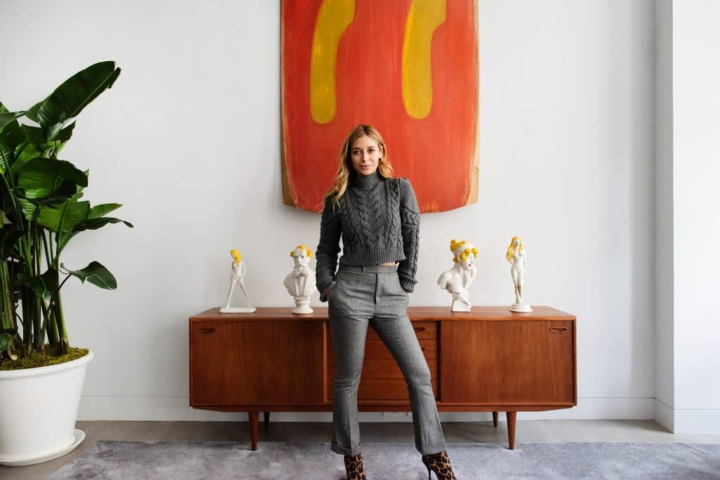 Jessica Schuster in front of a Ron Gorchov painting
