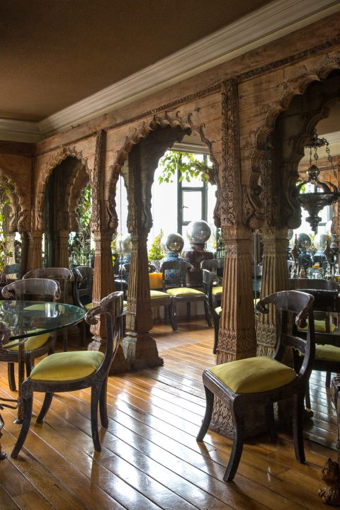 Carved wooden arches from India in Rodrigo Rivero Lake's dining room