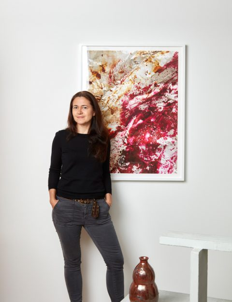 Alexandra Rowley stands in front of Untitled from her Process series