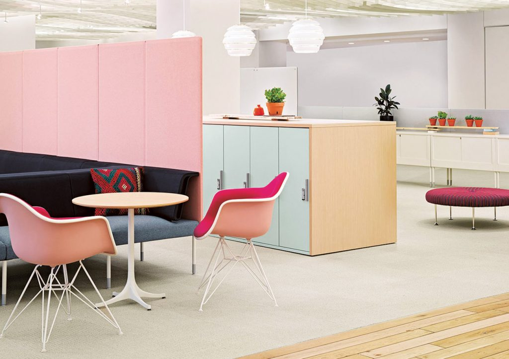 Herman Miller Furniture in an Office Setting Featuring Molded Plastic Eames Chairs and a table by Girard