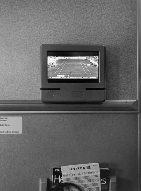 Stephan Würth photo of a tennis court on an airplane tv screen