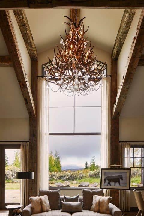 WRJ Design Associates Jackson Hole Wyoming Rush Jenkins Klaus Baer National Elk Refuge House living room elk horn chandelier view Grand Tetons Natural Elegance